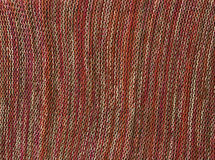 Brown knitted material texture. Stock Photography