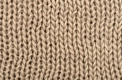 Brown knitted pullover background Stock Photo