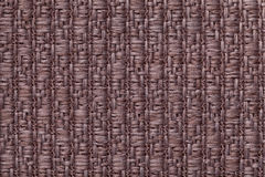 Brown knitted woolen background with a pattern of soft, fleecy cloth. Texture of textile closeup. Stock Photo