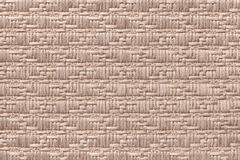 Brown knitted woolen background with a pattern of soft, fleecy cloth. Texture of textile closeup. Royalty Free Stock Photos