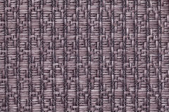 Brown knitted woolen background with a pattern of soft, fleecy cloth. Texture of textile closeup. Stock Images