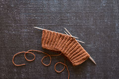 Brown knitting on black background Stock Photography