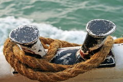 Brown knotted rope of the ship at berth Royalty Free Stock Photos