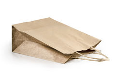 Brown kraft paper bag with copy space on a white background: Clipping path. Royalty Free Stock Photo