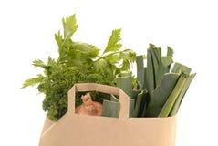 Brown kraft paper bag fulle of vegetables Stock Image