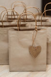 Brown kraft paper bags for gifts on background Stock Photo