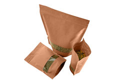 Brown kraft paper doypack pouch with zipper on white background with rectangle window with dry fruit Stock Photography