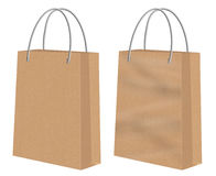 Brown kraft shopping paper bags. Plain brown Kraft shopping paper bags -one smooth the other creased or with chasms. Image isolated on white background Royalty Free Stock Photos
