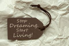 Brown Label With Quote Stop Dreaming Start Living Paper Backgrou Royalty Free Stock Photography
