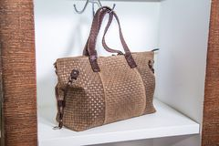 Brown ladies bag on the shelf in the store Royalty Free Stock Photography