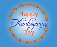 Brown leaf in circle with happy thanksgiving day inside on blue Stock Photos