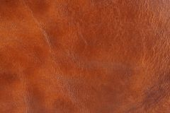 Brown leather. Natural brown leather background closeup Stock Photos