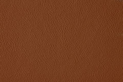 Brown leather background. Brown texture of leather background stock photos
