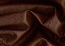 Brown leather. Background of creased brown leather Royalty Free Stock Image
