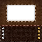 Brown leather background with metal rivets Stock Photography