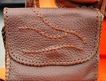 Brown leather bag with flap stock photography