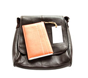 Brown leather bag,notebook and white card on wooden table Stock Image