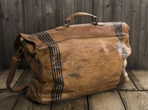 Brown leather bag. Rear of a brown leather satchel with black strips on sides for design Stock Images