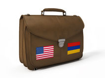 Brown leather bag with USA and Armenian flags Stock Photography