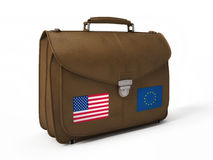 Brown leather bag with USA and European flags Royalty Free Stock Images