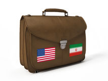 Brown leather bag with USA and Iranian flags Royalty Free Stock Photos