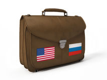 Brown leather bag with USA and Russian flags Royalty Free Stock Image