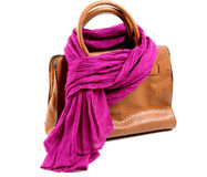 Brown leather bag and violet scarf Royalty Free Stock Images