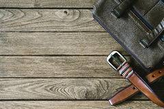 Brown leather belt and bag on the wooden table, top view with c. Opy space royalty free stock images