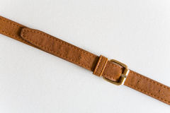 Brown leather belt with a buckle. stock images