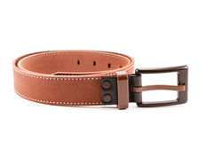 Brown leather belt isolated on white background Stock Photo