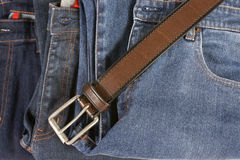 Brown leather belt and jean Stock Images