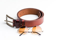 Brown leather belt for men and vintage glasses Royalty Free Stock Photo