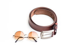 Brown leather belt for men with vintage glasses on white backgro Stock Photos