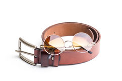 Brown leather belt for men with vintage glasses on white backgro Stock Image