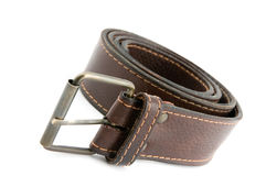 Brown leather belt with metal belt-buckle Royalty Free Stock Photo