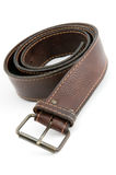 Brown leather belt with metal belt-buckle Stock Photos