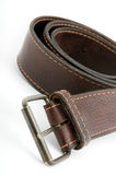 Brown leather belt with metal belt-buckle Stock Image
