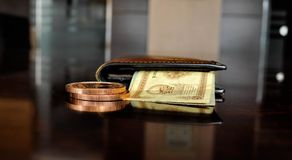Brown Leather Bifold Wallet With Banknotes Sticking Out Royalty Free Stock Images