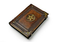 Brown leather book cover with gilded pentagram and the Ouroboros symbol, surrounded with deeply embossed frame and metal corners. Captured lay down from the stock photo