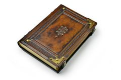 Brown leather book cover with the tree of life, Kabbalah symbol, surrounded with deeply embossed frame and metal corners royalty free stock photography