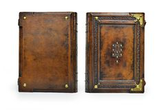 Brown leather book cover with the tree of life, Kabbalah symbol, surrounded with deeply embossed frame and metal corners. Captured stand up frontal royalty free stock image
