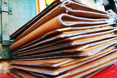 Brown leather books background on red table, close up Royalty Free Stock Photo