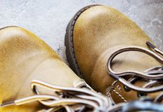 brown leather boot and laces stock images