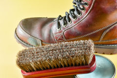 Brown leather boot and polish kit Royalty Free Stock Photos