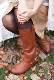Brown leather boots. On a girl Royalty Free Stock Photos
