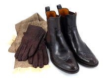 Brown leather boots with gloves and scarf Royalty Free Stock Image