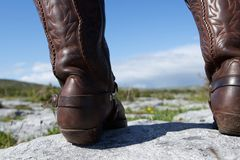 Brown leather boots standing on rock Stock Images
