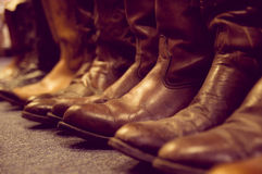 Brown leather boots. Brown vintage leather boots aligned selective focus royalty free stock photo