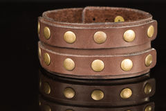 Brown leather bracelet isolated on a black Royalty Free Stock Images