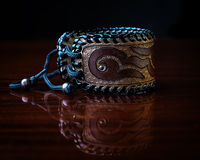 Brown leather bracelet isolated on a black Stock Photography